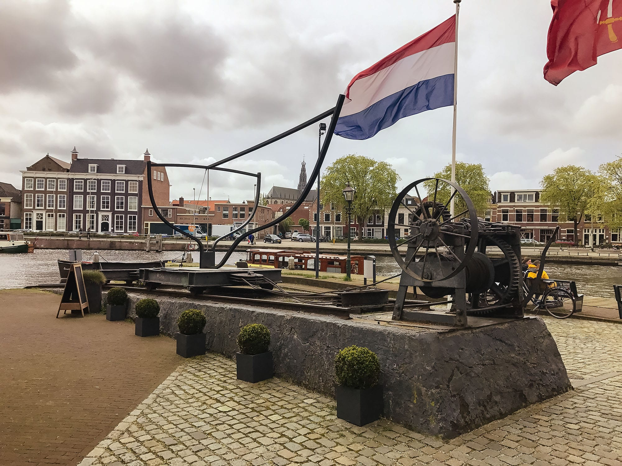 artist's representation of the shipyard outside de Adriaan Windmill
