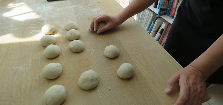 Rolling the bread dough into balls