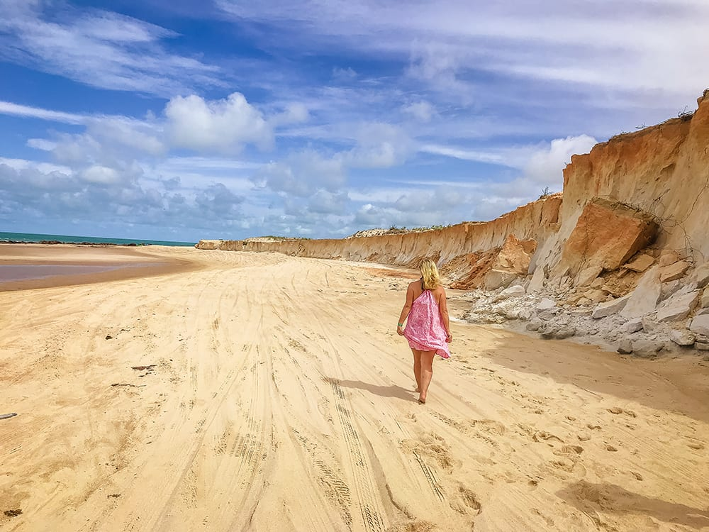 Strolling along the Canoa Quebrada beach in Ceará in North east Brazil