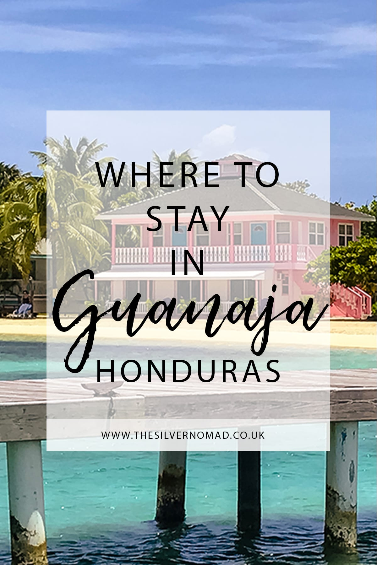Where to stay in Guanaja Honduras with pink house, sand and wooden jetty in the background