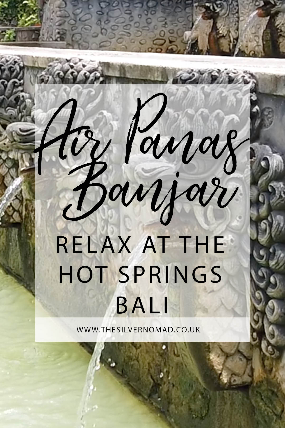 Air Panas Banjar relax at the Hot Springs Bali writing with image of stone-carved naga (dragon) spouting water