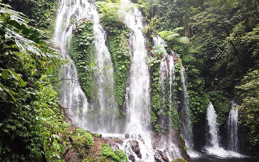 Banyumala waterfall in the North of Bali with 7 waterfalls surrounded by lush tropical vegetation