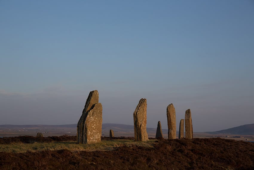 Neolithic standing stones against a blue sky
