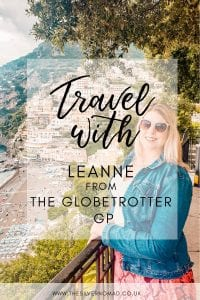 Travel Questions to Leanne from The Globetrotter GP with Leanne in the background wearing sunglasses and a denim jacket and standing in front of a hill
