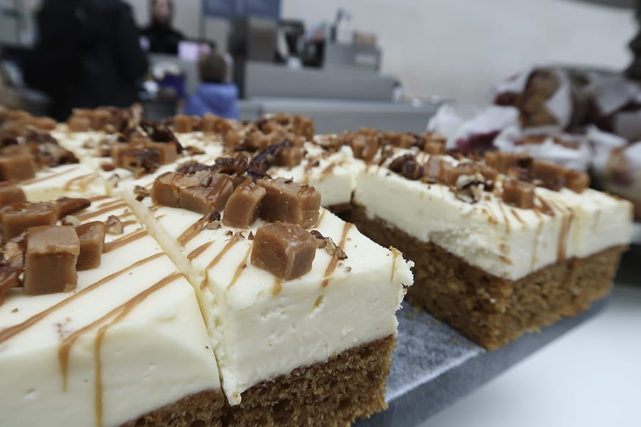 rectangles of sponge cake topped with thick frosting and cubes of caramel and toffee syrup available from one of the cafes at the British Museum