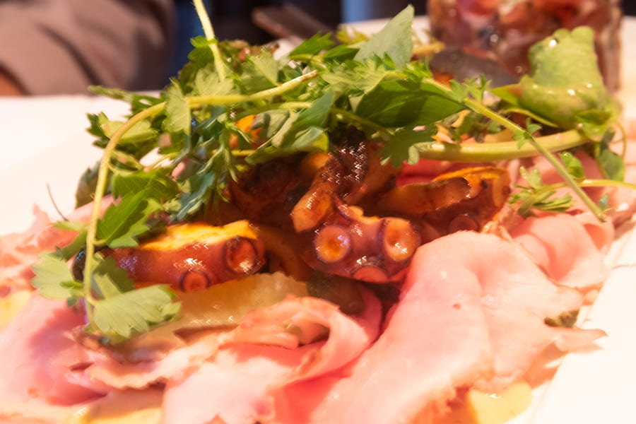 Ham with octopus and herb salad