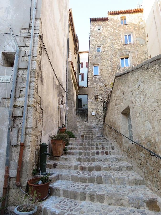 steps leading up between old buildings in Callas
