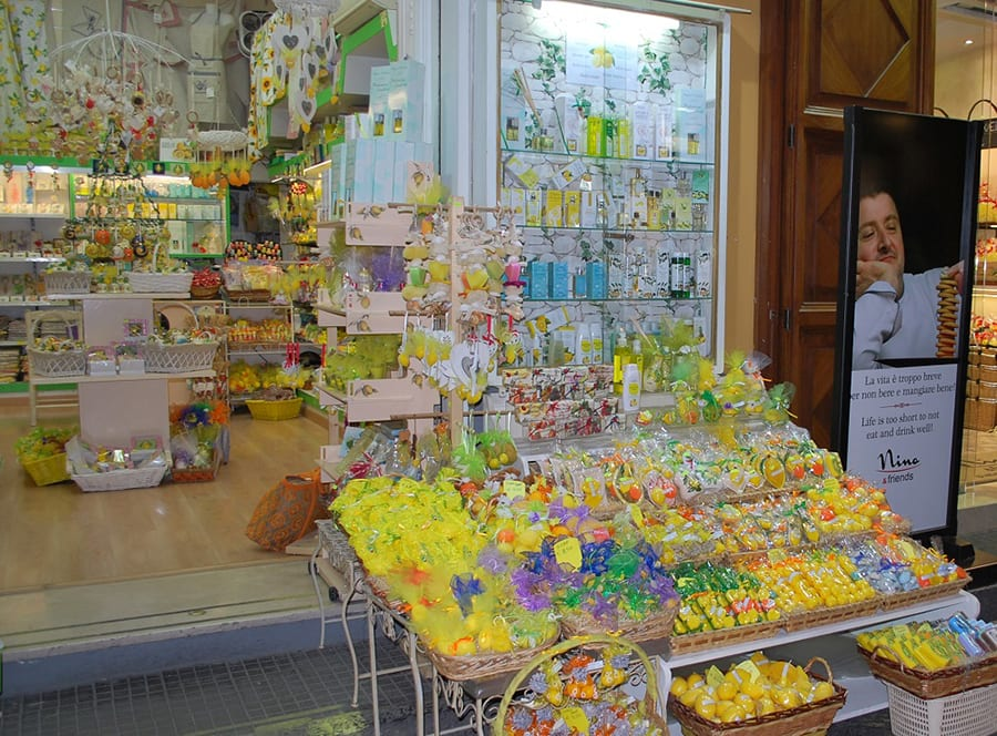 Shop in Sorrento, Italy with baskets of products outside mainly in yellow