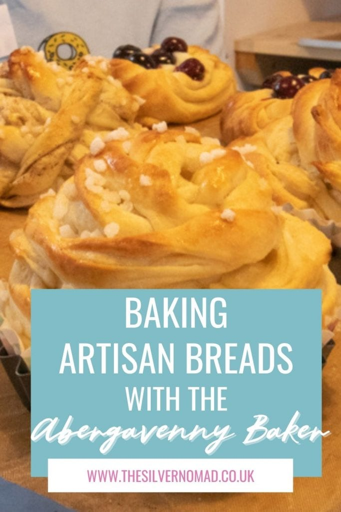 Image of baked sweet buns with white text overlay on pale blue saying Baking Artisan Breads with the Abergavenny Baker