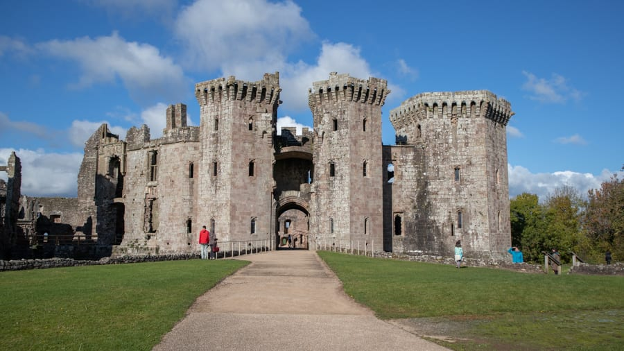 ruins of Raglan Castle with two main towers with arched entrance underneath