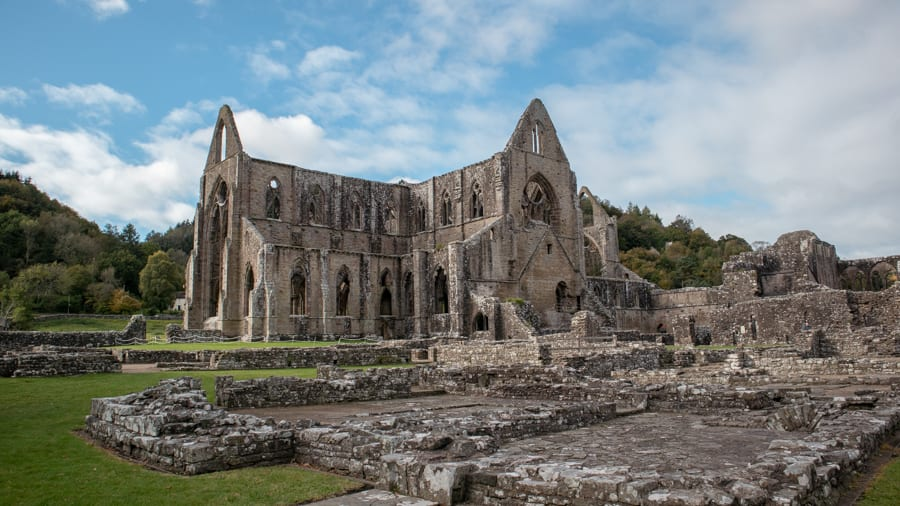 the ruins of Tintern Abbey with 3 gable walls visible
