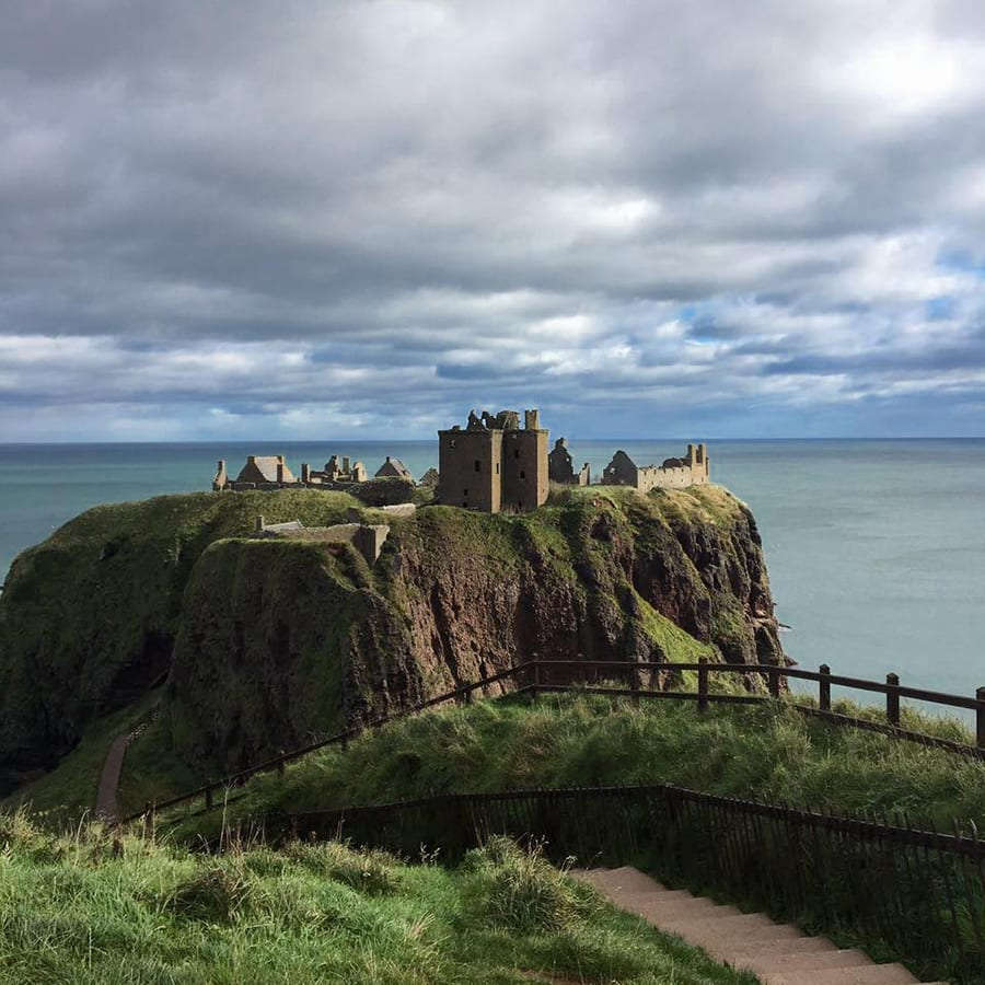 Dunnottar Caslte on an rocky outcrop with the sea below and behind