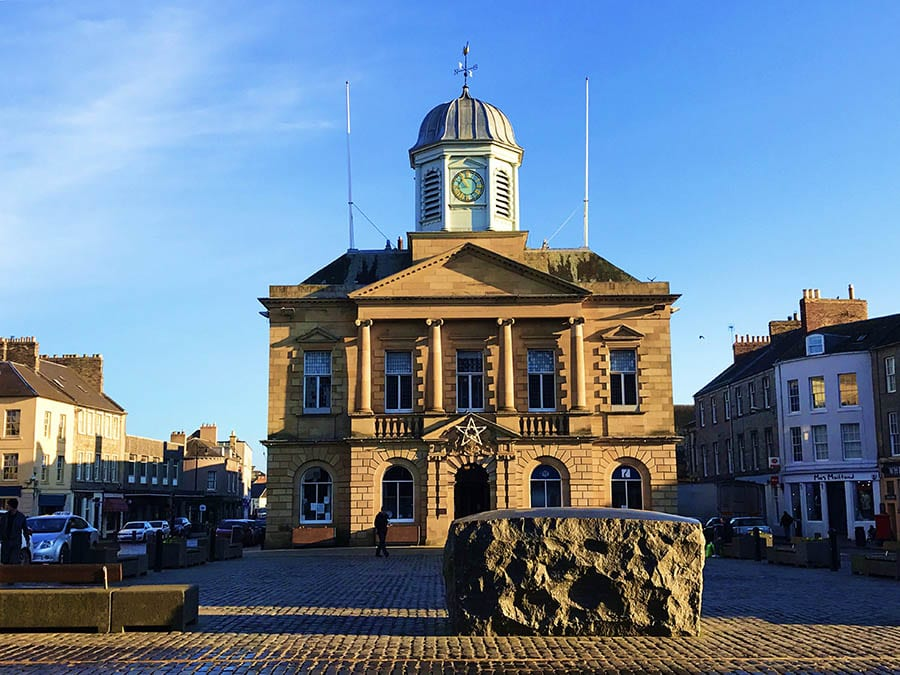 Town hall in Kelso Scotland with Kelsae Stane public artwork in front of it