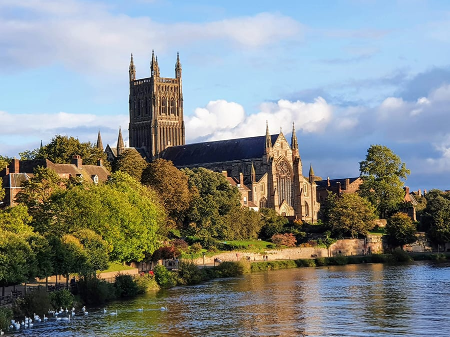 Worcester Cathedral standing on the banks of a river