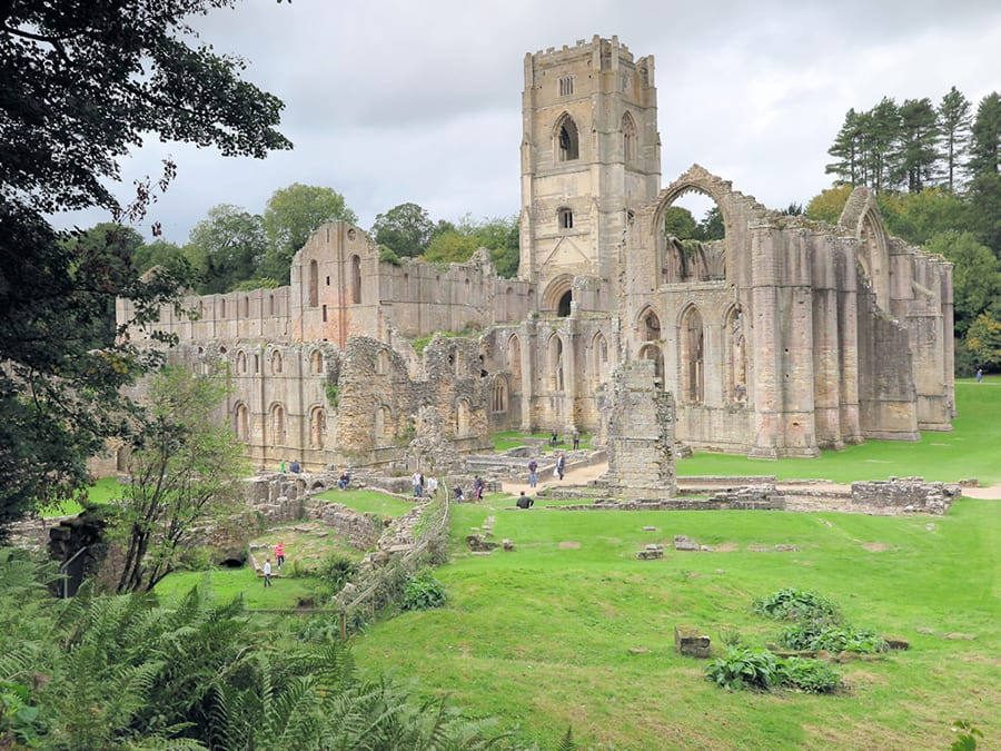 Ruins of a Fountains Abbey with green grass around