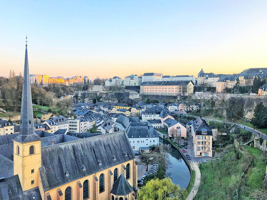 view over Luxembourg town and the slate coloured roofs on top of the long pastel buildings