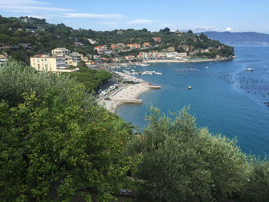 view over the coast to Portovenere with beaches and houses on the left and the sea on the righ