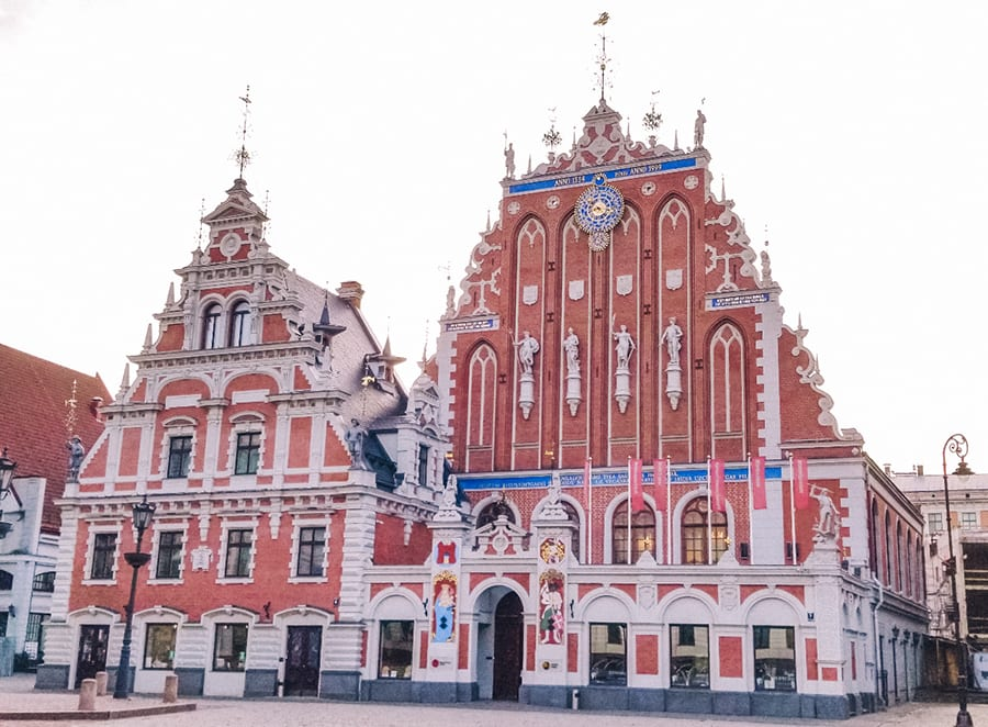 Ornate architectural red and white buildings in Riga