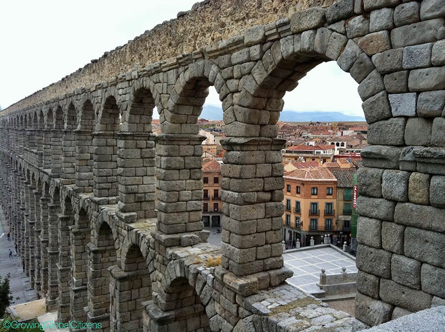 View of Segovia in Spain through the ruined arches of the
