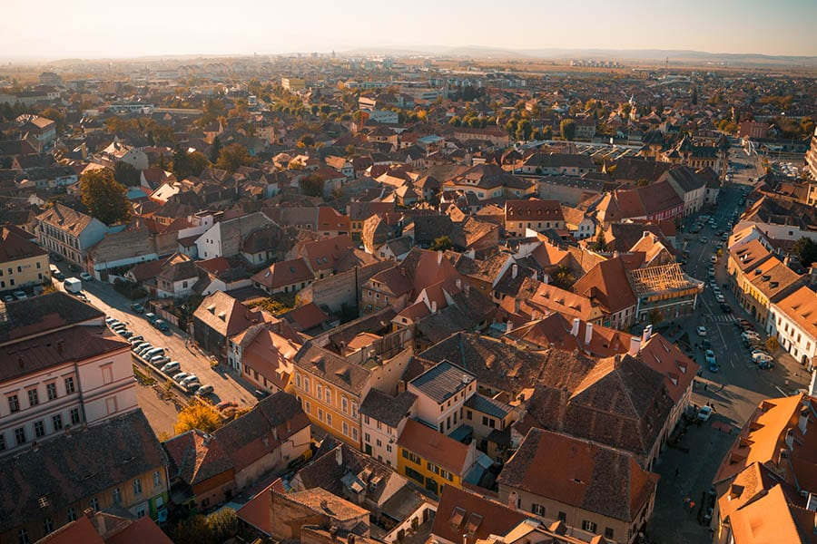 an aerial view of the red roofs of Sibiu in Romania